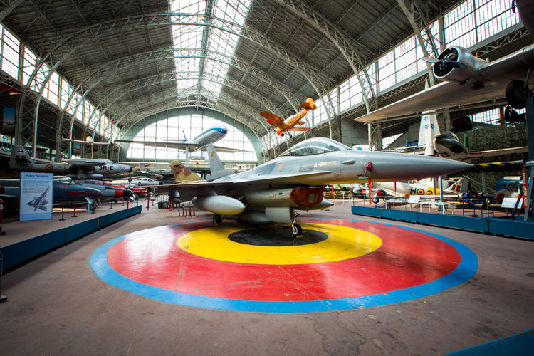 F-16 Fighter Jet Moments Of Happiness Indoors  Motion Architecture Day Industry Blurred Motion Factory Technology No People Water Arts Culture And Entertainment Skill  Built Structure Creativity Art And Craft Circle F-16 Fighter Jet Plane Museum Brussels