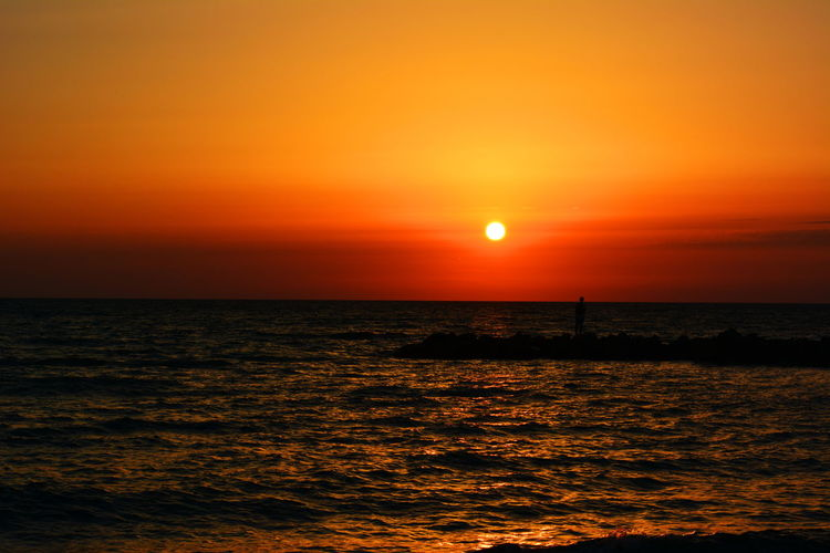 Sunset Sea Sun Horizon Over Water Beach Scenics Dramatic Sky Beauty In Nature Tourism Nature Travel Destinations Vacations Orange Color Horizon Water Sunlight Landscape Travel Reflection Sky