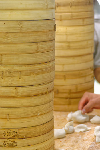 Bamboo Steamers Chinese Food Taiwanese Food Bamboo Steamer Chef Chefs Close-up Commercial Kitchen Commercial Kitchens Day Dim Sum Din Tai Fung Dumpling Skin Dumplings Food Food And Drink Food Preparation Freshness Holding Human Body Part Human Hand Indoors  Kitchen Making Men One Person People Preparation  Real People Steamed Dumplings Working