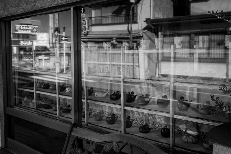 Reflection of train in glass window