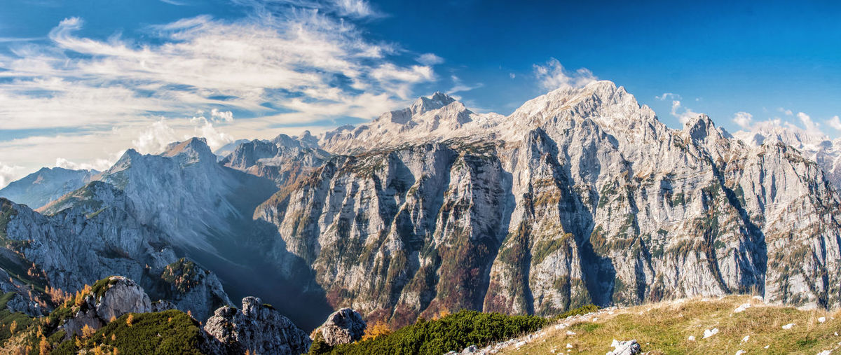 Autumn in Julian Alps in Slovenia, with view of Triglav Mountain Scenics - Nature Landscape Cloud - Sky Environment Sky Mountain Range Nature Beauty In Nature Mountain Peak Rock Tranquil Scene Wilderness No People Water Land Travel Destinations Tranquility Outdoors Panoramic Formation Slovenia Triglav National Park Autumn Hike