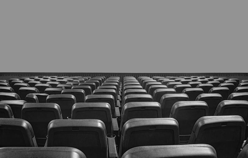 Empty seats and projection screen in movie theater