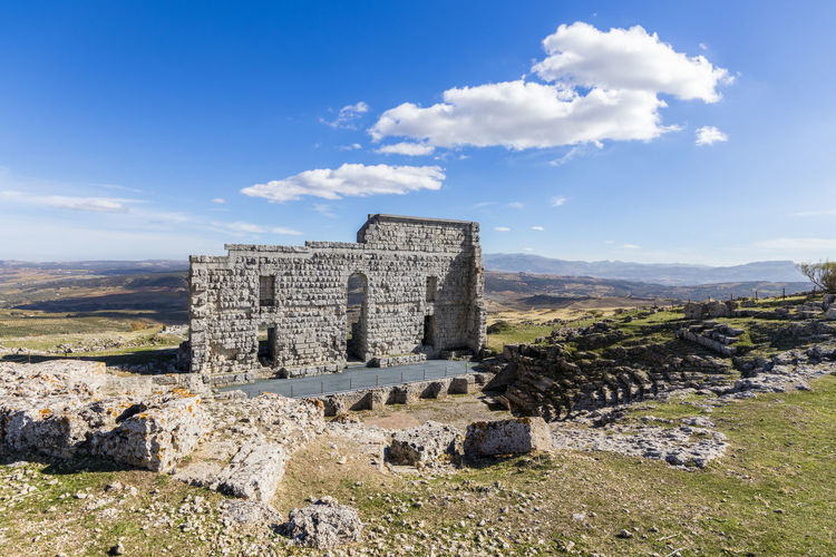 Old Ruin Building Against Blue Sky During Sunny Day