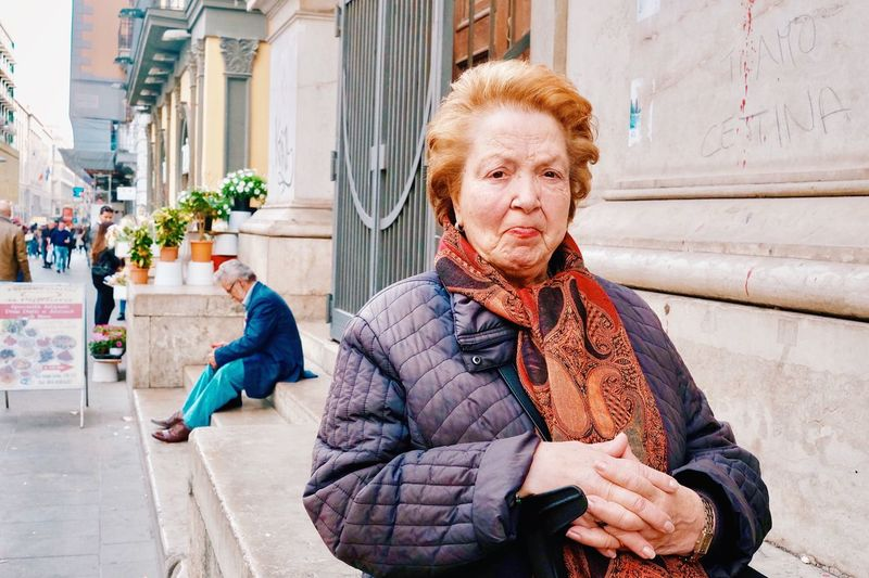 Portrait of man in city