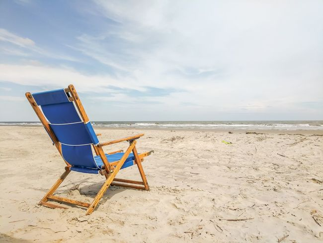 EyeEm Selects Beach Sand Sea Chair Summer Vacations Horizon Over Water Sky Water Relaxation Nature Tranquility Outdoor Chair No People Outdoors Scenics Day Beauty In Nature Kiawah Island South Carolina Beach Cloudscape
