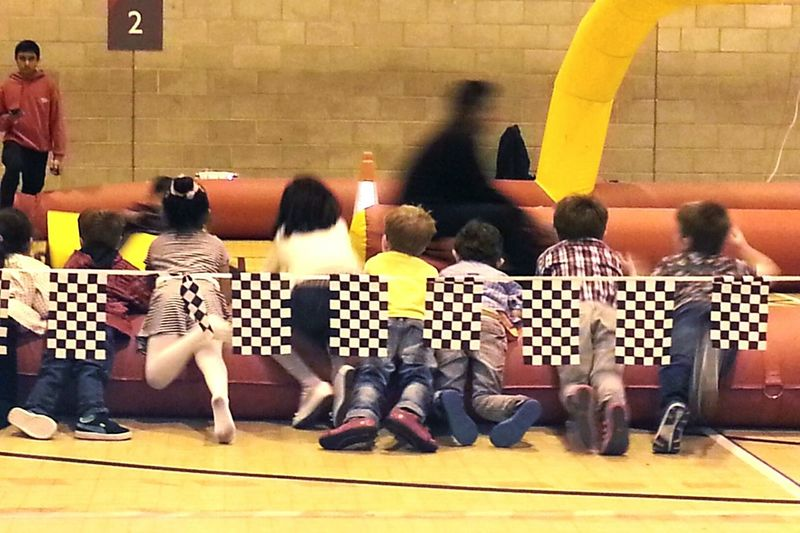 Indoors  Full Length Side View Medium Group Of People Togetherness Flooring Person Casual Clothing Subway Station Gokart Racing Go Karting Kids Playing Racing Car Racing Party Party Time Birthday Party Birthday