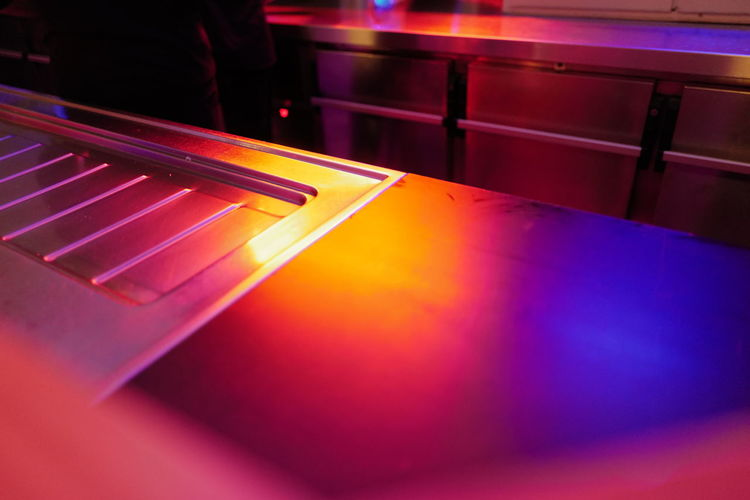 High angle view of illuminated lights on table