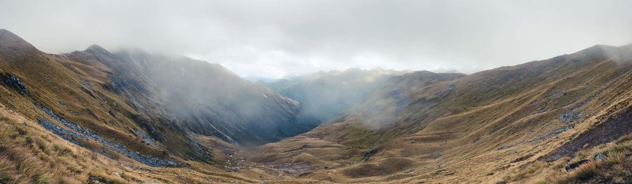 Panoramic view of mountains and foggy sky