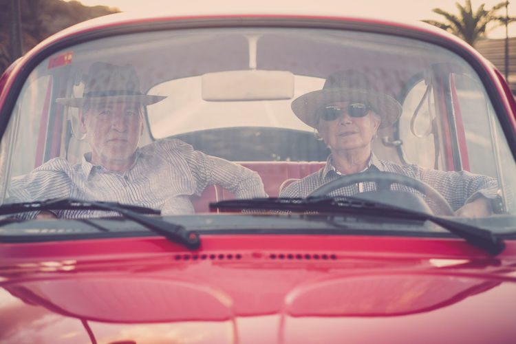 Portrait of couple sitting in car