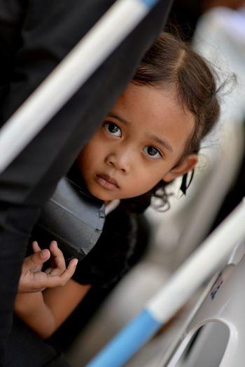 Close-up portrait of cute girl in car