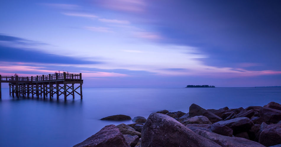 Calm Before the Storm Beauty In Nature Built Structure Charles Island Cloud - Sky Horizon Over Water Nature No People Outdoors Rock - Object Scenics Sea Seascape Sky Sunset Tranquil Scene Tranquility Water