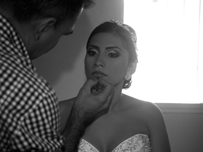 Man Applying Lipstick To Bride