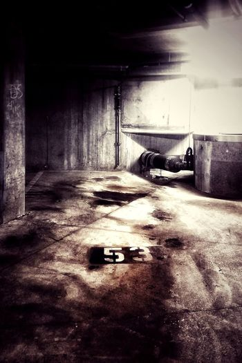Breathing Space Car Transportation Parking Lot Built Structure No People Parking Garage Architecture Indoors  Basement My Point Of View Experimental Photography Parking Lot Parking Spot Parking Space Garage Empty Space 53 Number 53 Eerie Still Life Dark Run Down Empty