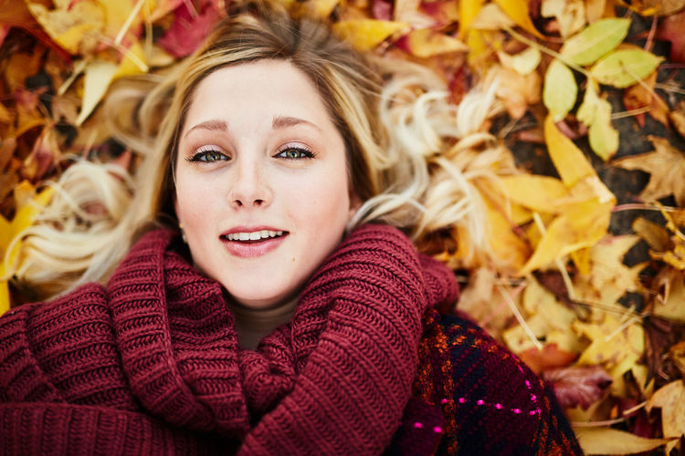 Adult Adults Only Autumn Beautiful People Beautiful Woman Beauty Beauty In Nature Blond Hair Change Dry Headshot Leaf Long Hair Looking At Camera One Person One Woman Only One Young Woman Only Only Women Portrait Scarf Smiling Sweater Warm Clothing Young Adult Young Women