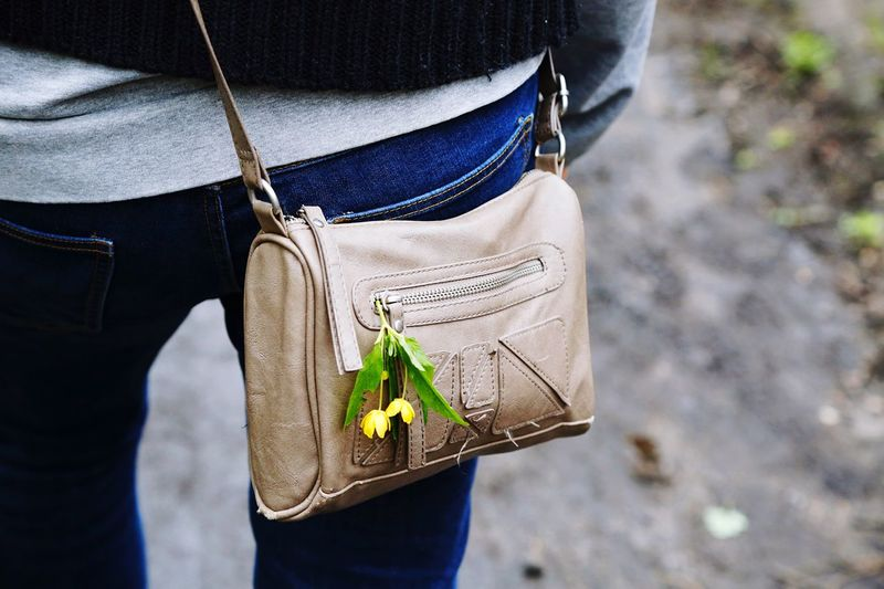 Midsection of woman wearing bag