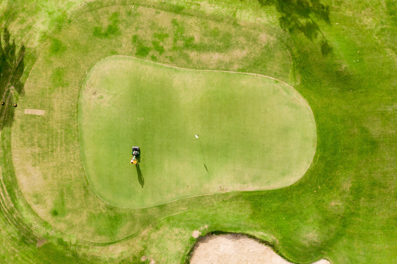 sport, leisure activity, plant, activity, grass, day, nature, people, golf, tree, green color, outdoors, real people, lifestyles, men, high angle view, golf course, land, field