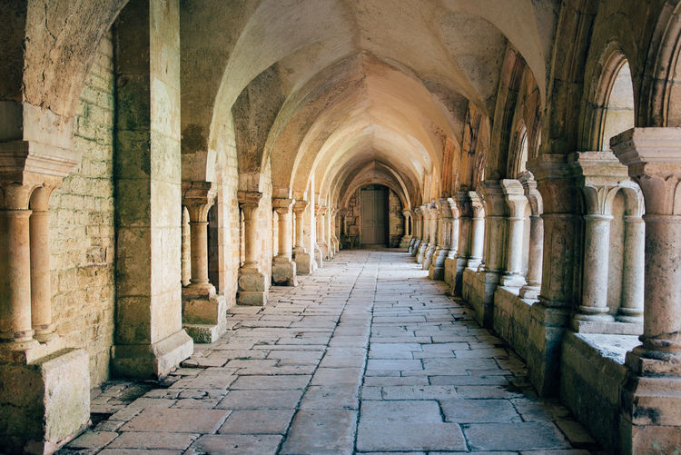 Monastery Place Of Worship Old The Past History Historical Building MedievalTown Medieval Architecture Medieval Arch Architecture Architectural Column Arcade Built Structure Building Corridor Indoors  In A Row Direction The Way Forward Diminishing Perspective Colonnade No People Religion Day Ancient Abbey Ceiling Ancient Civilization Ruined