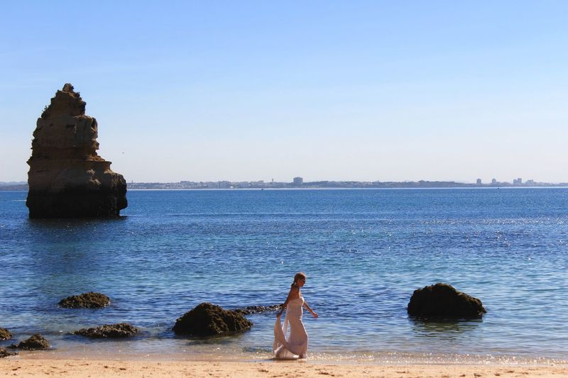 Sea Water Beach Real People Rock - Object Beauty In Nature Scenics Clear Sky Nature Leisure Activity Outdoors Tranquil Scene One Person Horizon Over Water Sky Lifestyles Day Women Standing Architecture