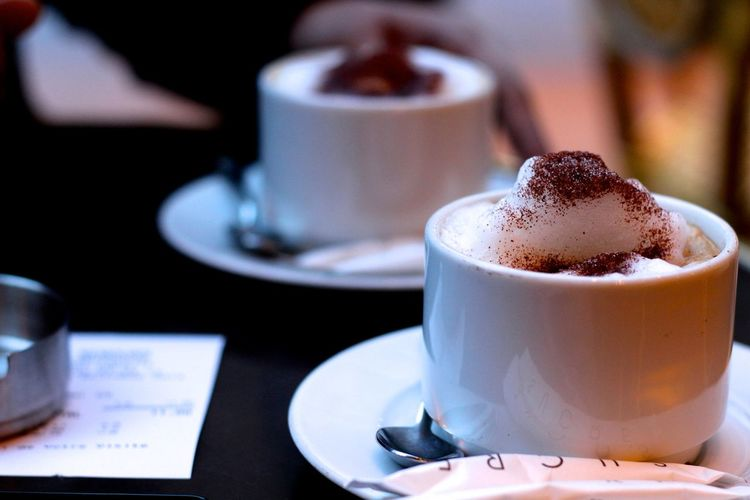 Close-Up Of Fresh Coffee Cups With Cinnamon