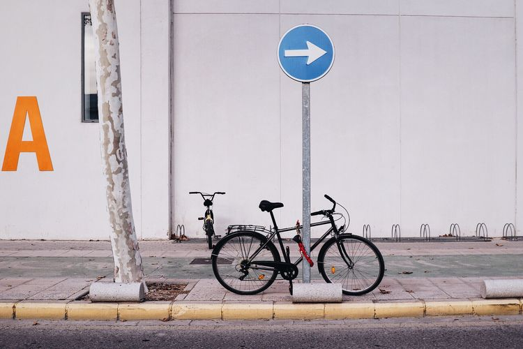 One Direction Bycicle Bycicles Bike Bikelife Signs Direction Streetphotography Street Urban Geometry Urban Lifestyle Healthy Lifestyle Environmental Conservation Green Climatechange Tree Scene No People Afternoon Walk Outdoors Minimalism Simplicity Composition Wall Visual Trends SS16 - Urbanity