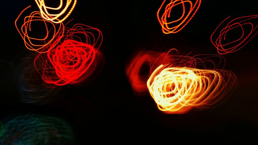 Close-up of light painting against black background