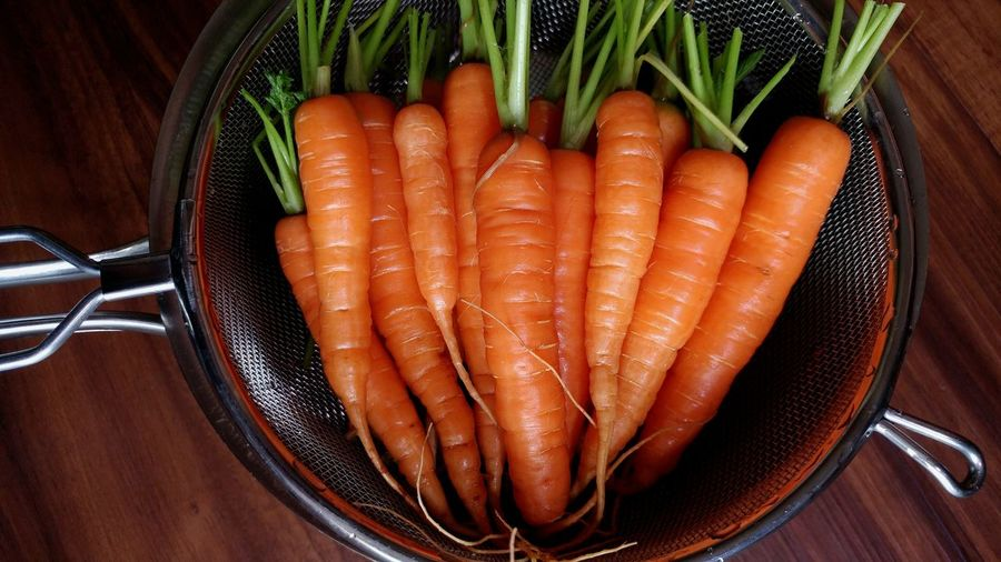 High Angle View Of Carrots In Strainer On Table