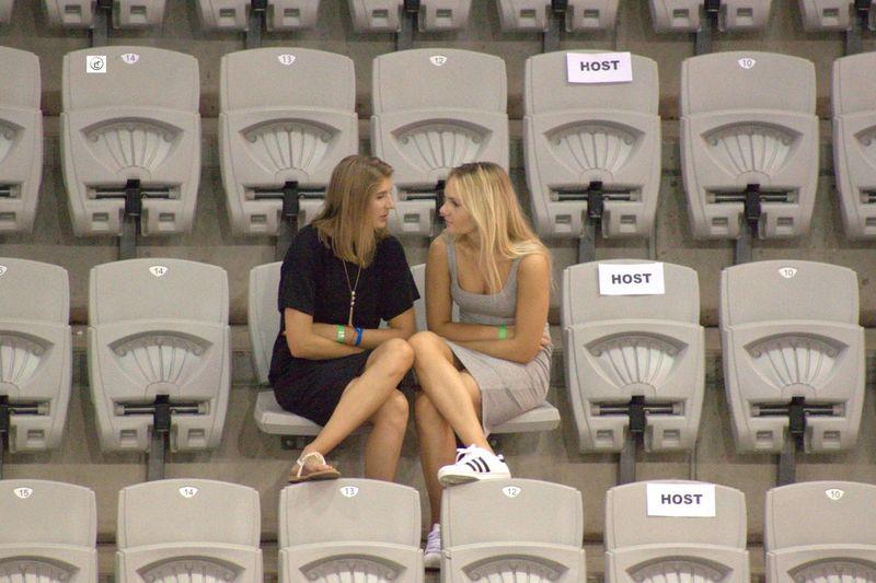 2 Girls Day Friends Mirror Image Posture Sitting Stadium Talking