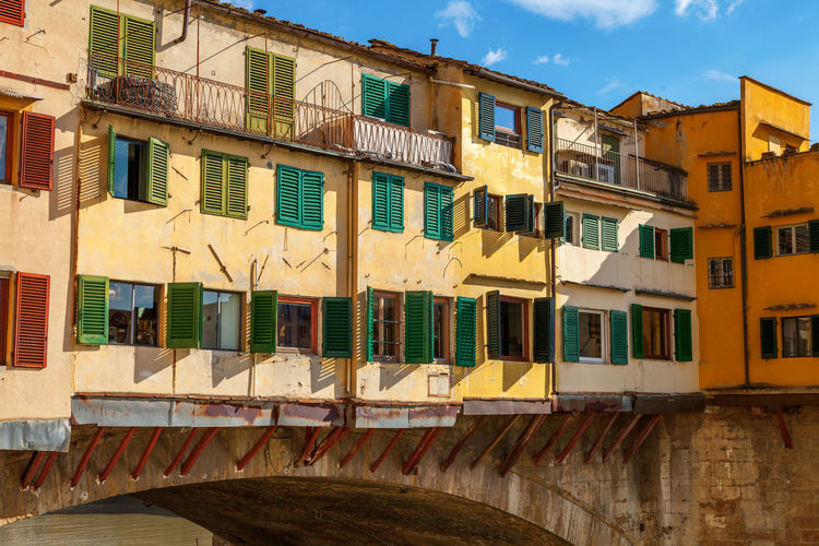 Rear view of old buildings on the Ponte Vecchio, Florence Italy Arno River Bright Shutters Architecture Building Exterior Built Structure Day Europe Florence Italy Medieval No People Outdoors Overhanging Rickety Sky Window Windows Yellow