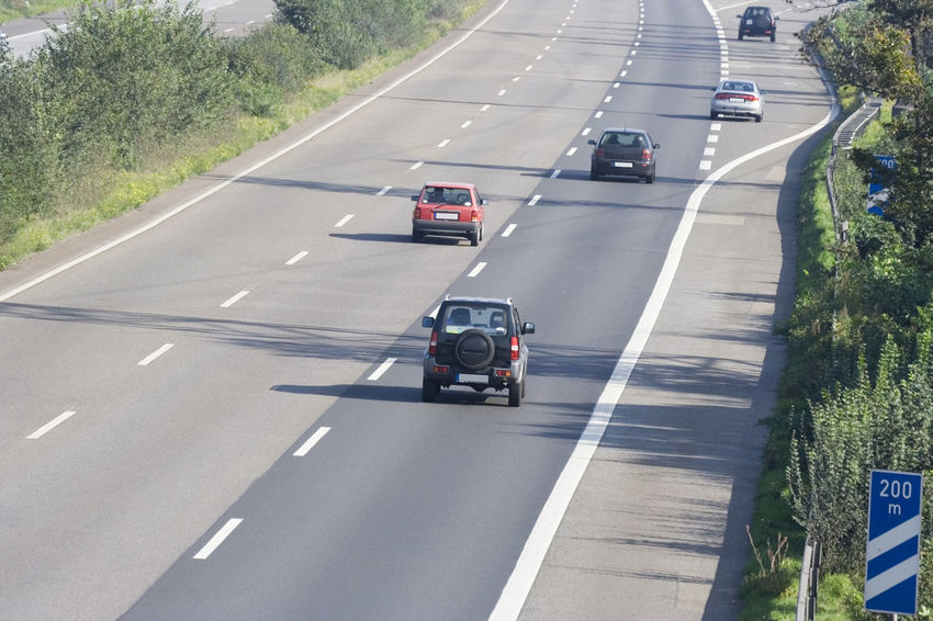 three-lane autobahn near an exchange - oberhausen, germany A42 Asphalt Auto Autobahn Car Driving Exit Fast Freeway Freeway Scenery Germany High Angle View Highway Highways&Freeways Land Vehicle No People NRW Oberhausen Road Ruhrgebiet Small Group Of Objects Speed Traffic Transportation Travel