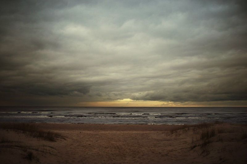 Sea Beach Horizon Over Water Cloud - Sky Sky Scenics Sand Beauty In Nature Water Nature Tranquility Tranquil Scene Shore Sunset Storm Cloud No People Wave Outdoors Travel Destinations Vacations