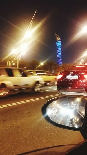 The Torch Tower Al Waab Street Busy Road From A Car Window