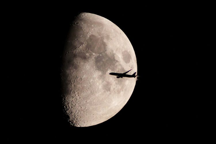 Low angle view of airplane against sky at night