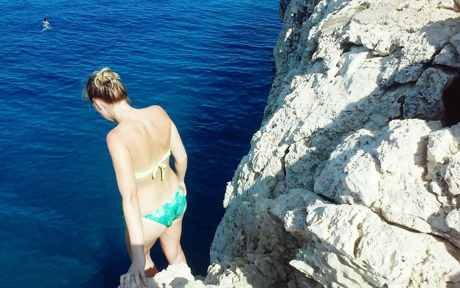 Blue Jumping Summer Fun Looking At The Sea Woman In Bikini People Sea Cliff Jumping Island Adventure Cliff Rocks Rocks And Water Cliff Diving Sky