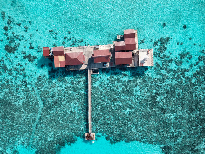 Aerial view of a tropical island in turquoise water.