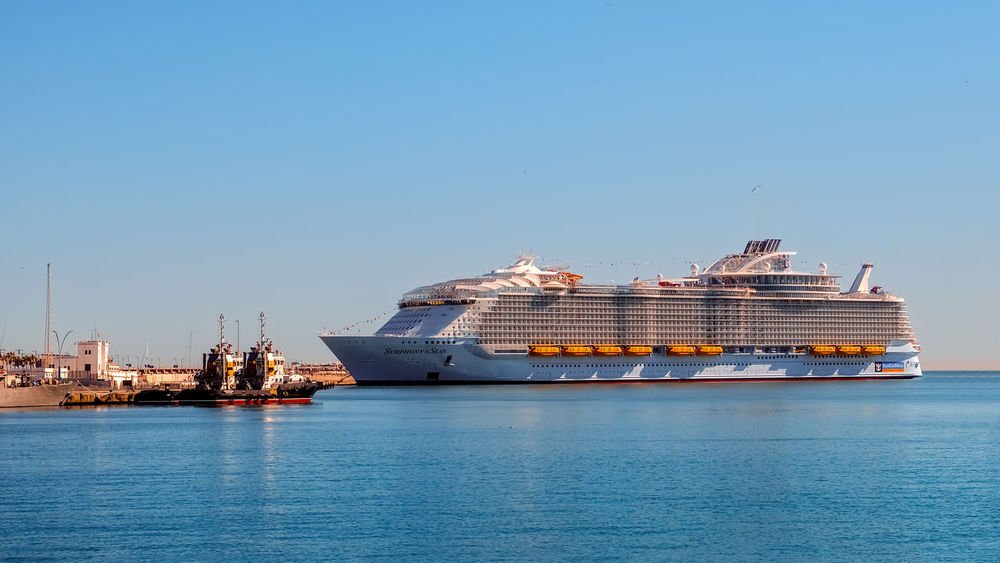 Malaga, Spain - March 27, 2018. Luxury cruise ship Symphony of the seas, Royal Caribbean, anchored in the port of Malaga Caribbean Sea Cruise Liner Cruise Ship Harbor Luxury Travel Malaga Royal Caribbean Cruise SPAIN Symphony Architecture Big Ship Blue Building Exterior Cargo Container Cityscape Clear Sky Day Freight Transportation Luxury Life Luxury Lifestyle Mode Of Transport Nature Nautical Vessel No People Outdoors Port Sea Seas Sea Ship Shipping  Sky Transportation Water Waterfront EyeEmNewHere