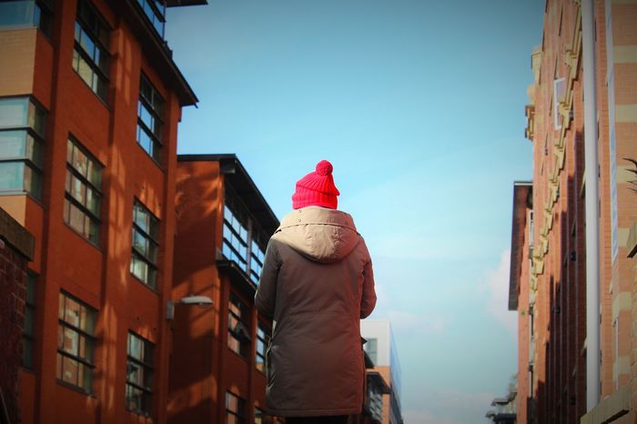 Blue Sky Blue Sky White Clouds Bobble Hat  Buildings & Sky City Life Coat Composition Low Angle View Outdoors Red Hat Woolly Hat