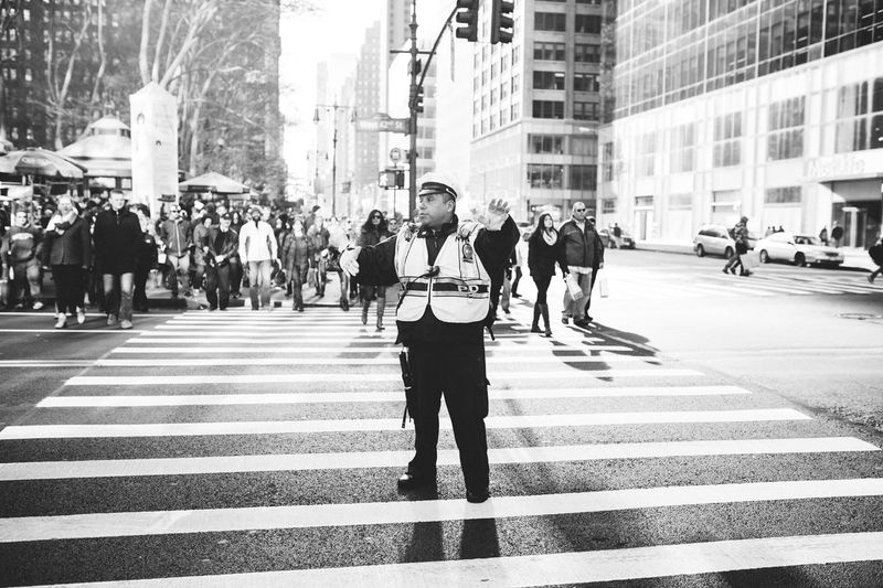 Police officer directing cars Streetphotography New York City New York Policeman