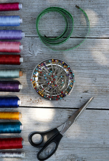 Scissors Sewing Architecture Art And Craft Choice Circle Creativity Day Directly Above Equipment High Angle View Hobby Indoors  Multi Colored Needle No People Shape Still Life Table Thread Tire Variation Wall - Building Feature Wheel Wood - Material