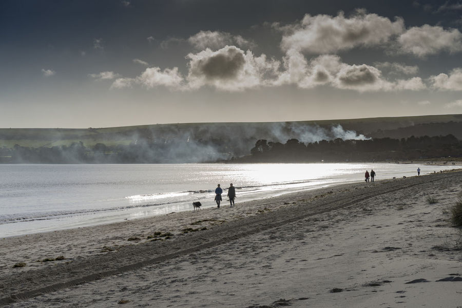 Smoke drifting over Studland beach and bay, Dorset, UK Smoke Beach Beauty In Nature Day Nature Outdoors Real People Sand Scenics Sea Sky Smoke Over Water Studlandbay Water