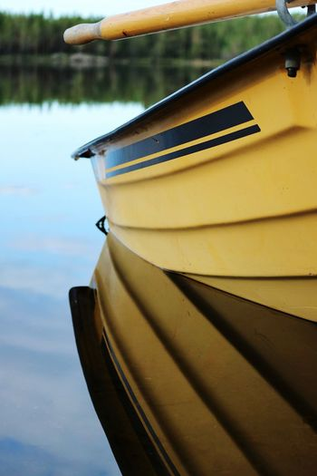 Mode Of Transportation Nautical Vessel Water Transportation Day Close-up Reflection Moored No People Nature Yellow Lake Outdoors Focus On Foreground Wood - Material Waterfront High Angle View Sunlight Rowboat Architecture