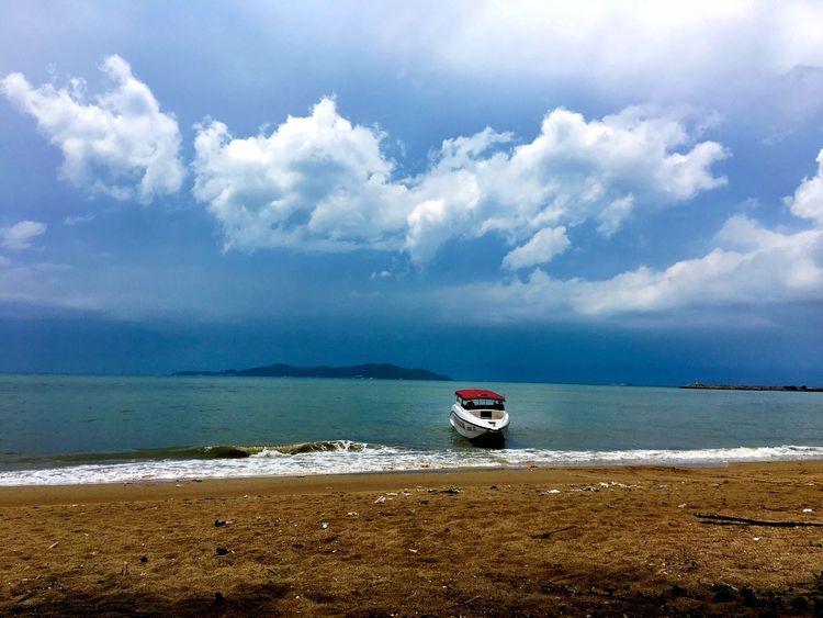 Cloudy day over the sea Cloud - Sky Sky Sea Water Beach Land Beauty In Nature Scenics - Nature Transportation Nautical Vessel Tranquility Tranquil Scene Nature Horizon Over Water Day Non-urban Scene Mode Of Transportation Sand Horizon Outdoors
