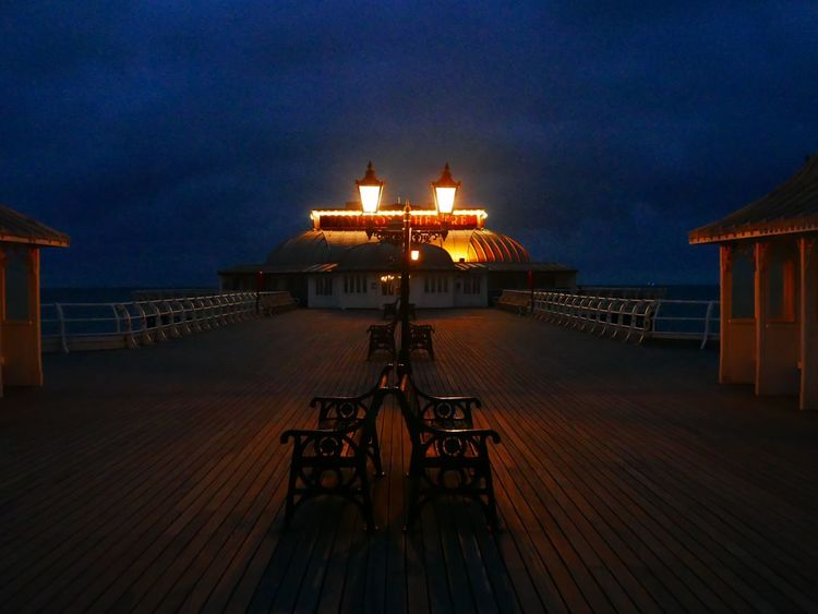 Cromer Pier Illuminated Dusk Sky Built Structure No People Architecture Sea Outdoors Nature Water Beauty In Nature Night Beach Chair Bench Cromer Cromer Pier Pier Wood Lines Atmospheric Atmospheric Light