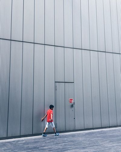 Boy City Day Full Length Lifestyles London Minimal Minimalism Minimalist One Person Only Boys Outdoors Pedestrian People Real People Red Shirt Strideby The Street Photographer - 2017 EyeEm Awards Young Adult