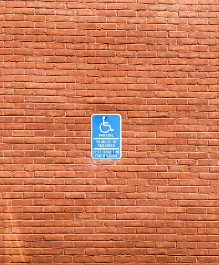 Disabled Parking. Minimalism Minimal Minimalist Handicap Handicapped Sign Handicapped Handicap Parking Brick Wall Building Exterior Outside Assist Help Warm Complimentary Colors Regulations Accessibilité Accessibili Disability Parking Signs Law Government Disabled Person Park Parking Lot