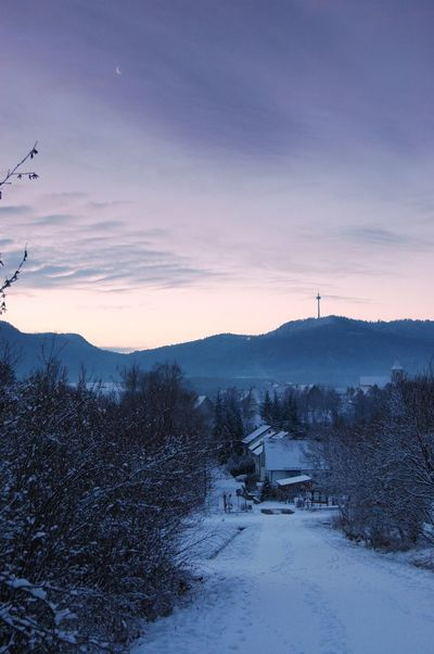 The sky brightens over the Radio Tower Baden-Württemberg  Deutschland EyeEmNewHere Hills Radiotower Schnee Beauty In Nature Built Structure Cold Cold Temperature Germany Landscape Mountain Nature No People Outdoors Scenics Sky Snow Sunset Tranquil Scene Tranquility Tree Winter Zollernalb