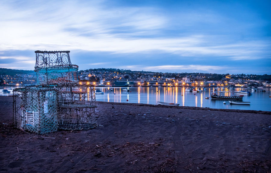 Fishermen lobster pots drying on the red sanded beach at Shaldon in Devon Harbour Harbour View Seaside Life Shaldon Teign Estuary Twightlight Beach Cityscape Cloud - Sky Harbour Lights Illuminated Lobster Pots Long Exposure River Ferry Sea Seascape Seaside Seaside Town Teignmouth Teignmouth Beach Water