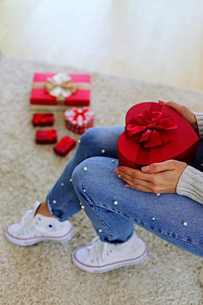 Indoors  One Person Ribbon - Sewing Item Red Christmas Gift Christmas Present Full Length Low Section Women Sitting Real People Day Human Body Part Close-up People Adult