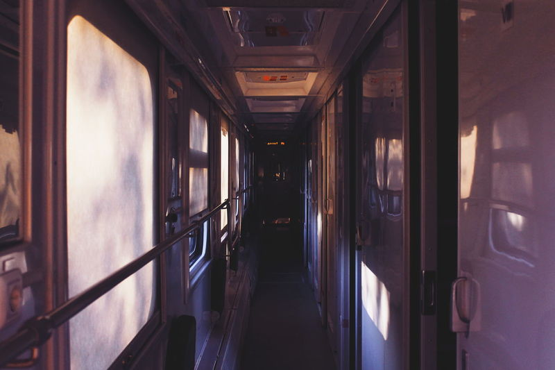 Purple Morning Rail Transportation Train Mode Of Transportation Transportation Public Transportation Train - Vehicle Indoors  No People Travel Passenger Train Empty Door Day Window Absence Purple Light Perspective Velvet EyeEm Best Shots The Week on EyeEm The Week on EyeEm Editor's Picks Train Interior Vehicle Interior
