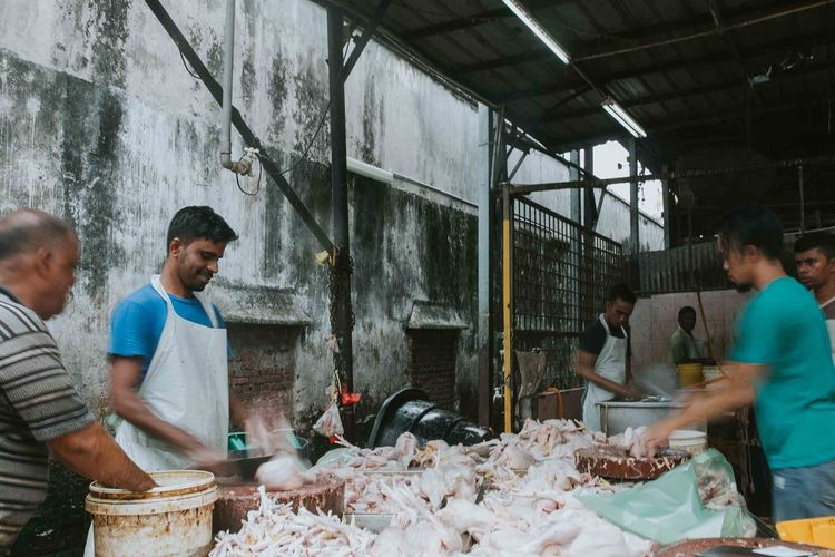 Men working at butcher shop