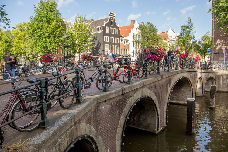 Amsterdam Netherlands Arch Arch Bridge Architecture Bicycle Bikes Bridge Bridge - Man Made Structure Building Building Exterior Built Structure Canal Canal House City Connection Day Dutch Houses Herengracht Holland Land Vehicle Mode Of Transportation Nature Outdoors Plant River Tourism Transportation Water